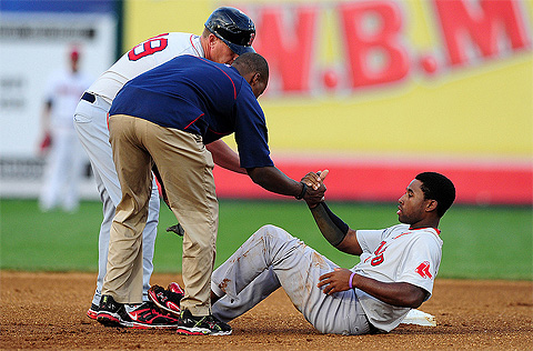Jackie Bradley is evaluated by staff after hurting his ankle on Monday.